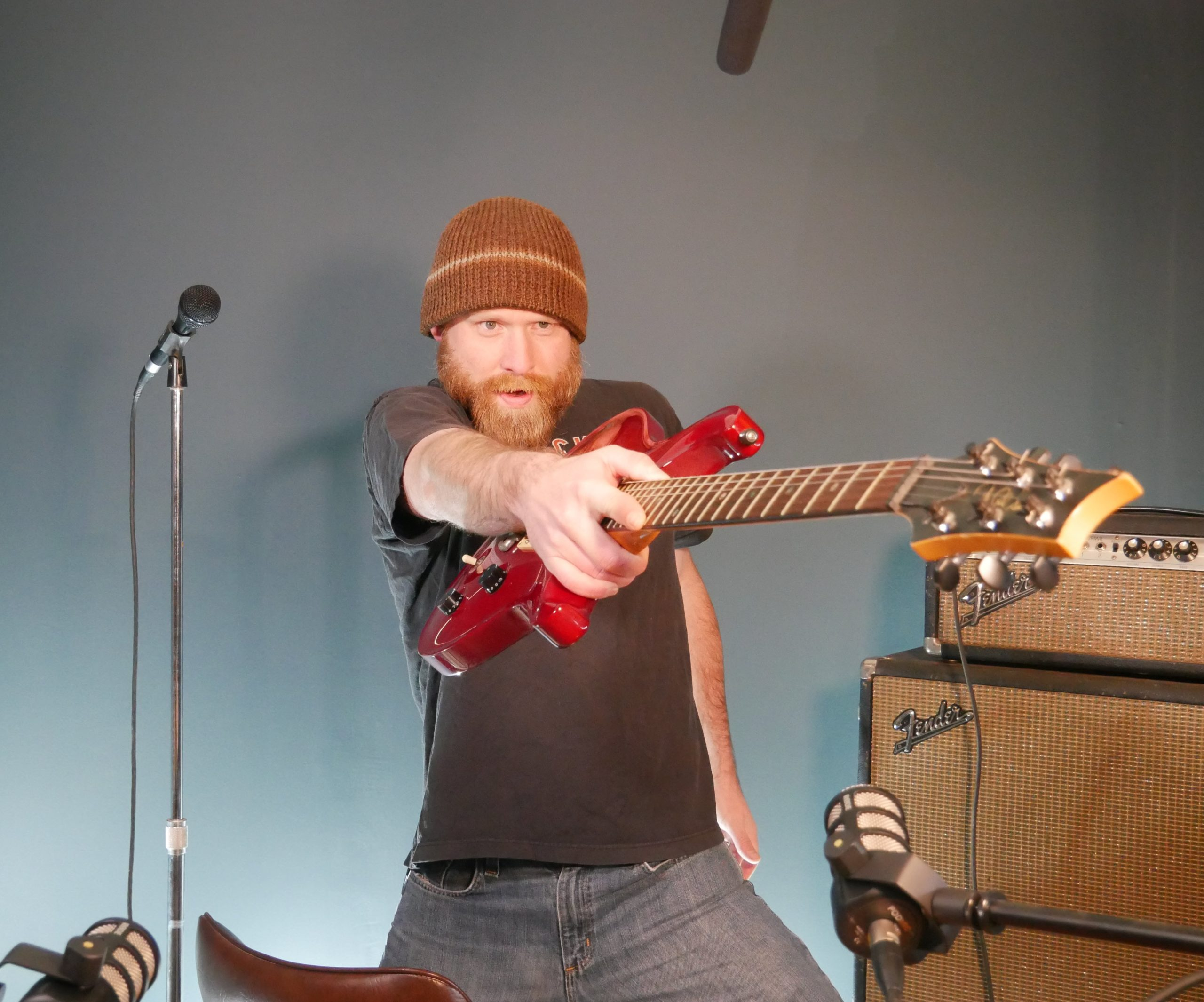 josh from microphone basics with his guitar